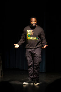 Pictured, is actor Scott St. Patrick during a monologue on the repressive nature of the government towards the African American community. One of the topics he talked about was mass incarceration and how African American communities are disproportionately targeted and destroyed as a result of this. Photo by Alonso Hernandez