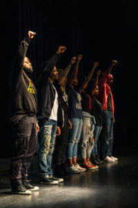 The actors of the Minority Report raise their fist in solidarity with the African American community and the social injustices and discrimination that they face throughout the country. The play sheds light on several lesser known issues that have a very big impact on the African American community. Photo by Alonso Hernandez