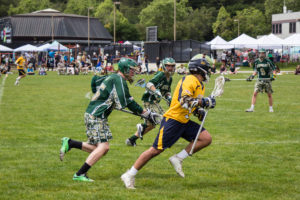 A UCSC attacker carries the ball down the field, pursued by a Humboldt defender during the Slug's resounding 16-2 win over Humboldt State. Photo by Alonso Hernandez