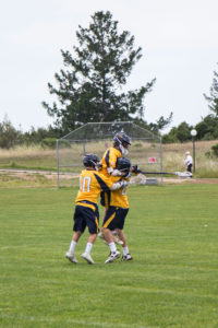 Members of the UCSC men's lacrosse team celebrates after scoring a goal during Saturday's game, the first the team actually played at home. Photo by Alonso Hernandez