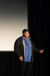 """Stevenson College alumnus Michael Rangel's spoken word poetry touched upon issues such as the extreme racism and violence many communities in South Los Angeles suffer from, as well as the controversial """"Cinco de Drinko"""" events held on campus in 2015. Photo by Danielle Del Rosario"""