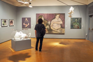 A visitor admires art in the Sesnon Gallery. All Irwin Scholars' art is interwoven throughout the three spaces, providing a cohesive experience and challenging gallery norms. Photo by Alonso Hernandez