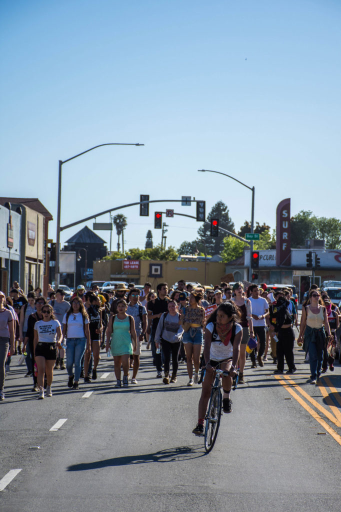 Students walk to Beach Flats later than anticipated because they maintained  the campus closure through the end of UCSC custodial employee shifts. Photo by Alonso Hernandez