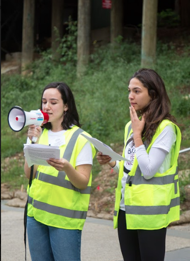 UCSC's Women's Center interns Laura Wishart (left) and Morgan Bostic (right) co-coordinated this year's Take Back the Night event. They kicked off the march at Quarry Plaza with a quick introduction. Photo by Danielle De Rosario