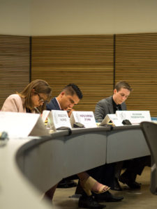 Attendees take notes during a simulation of a meeting discussing the conflict in the South China Sea. Participants were given a country which they had to represent during this meeting, pictured are the delegates from the Phillipines, China and Russia. Photo by Alonso Hernandez