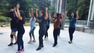 Los Mejicas, a Mexican folk dance group, practices for an upcoming performance in the McHenry Library courtyard. It is common for dance groups unaffiliated with OPERS to practice in spaces unintended for dance because of a lack of availability at the OPERS dance studio. Photo by Shinae Lee