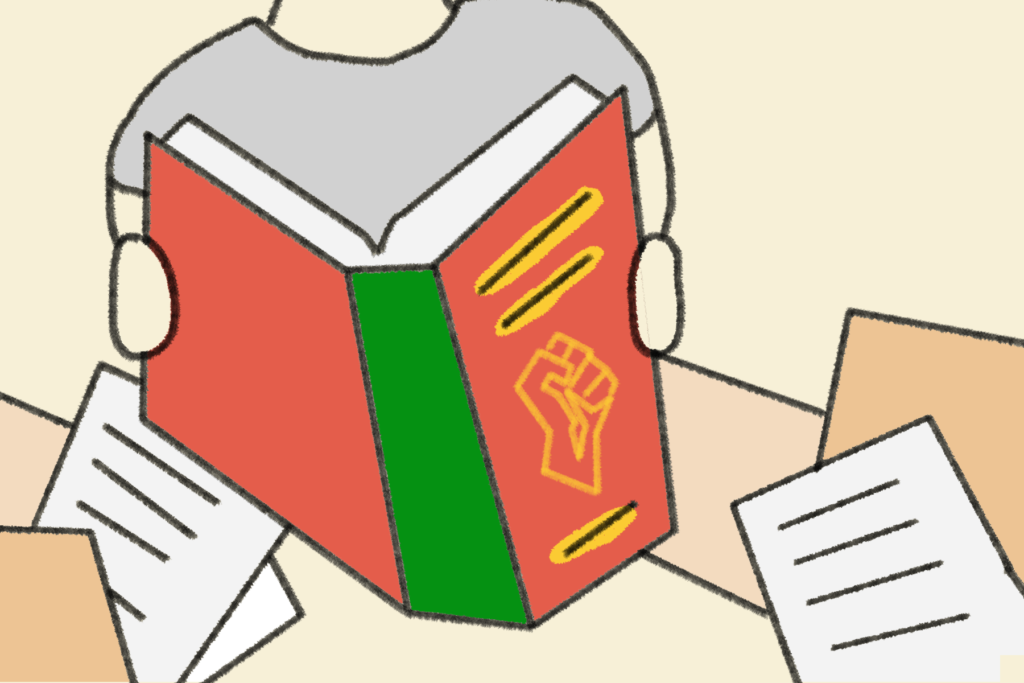 A person reading a book that has a black power fist on the cover.