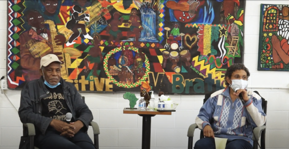 Danny Glover and Rev. Deborah Johnson speak in front on a mural at the Barrios Unidos community center.