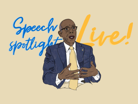 An illustrated portrait of Michael Drake giving a live speech.