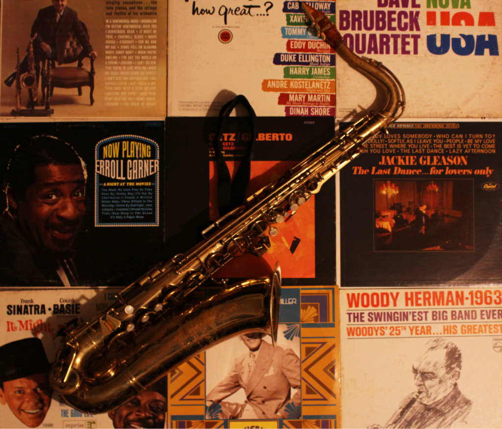 A saxophone on an array of records.