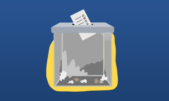 An empty ballot box in front of a navy blue and yellow background.