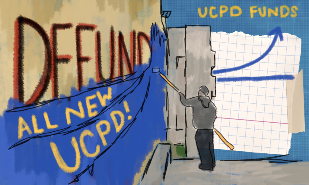"""A wall that says """"defund"""" is being covered and painted over. The wall now says """"all new U C P D."""" In the background, there is a graph of an increase in UCPD funding."""