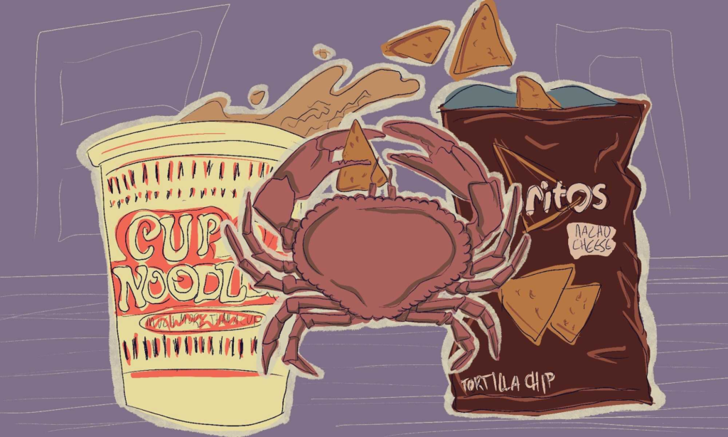 A crab eating chips and instant ramen.